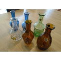 A Collection of 6 Daphni Wine Festival Retro Bottles